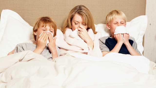 gty_family_sick_in_bed_flu_thg_130108_wg